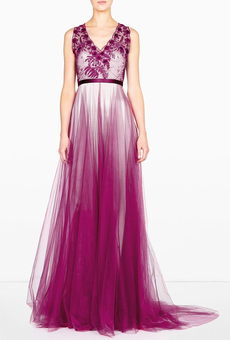 The rich magenta and champagne tones on this Catherine Deane gown would make a unique wedding gown.
