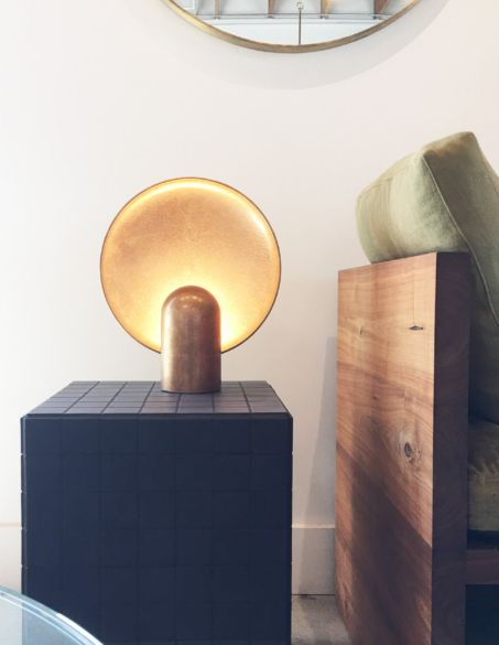 The surface sconce table lamp by talented australian industrial designer henry wilson solid cast gunmetal