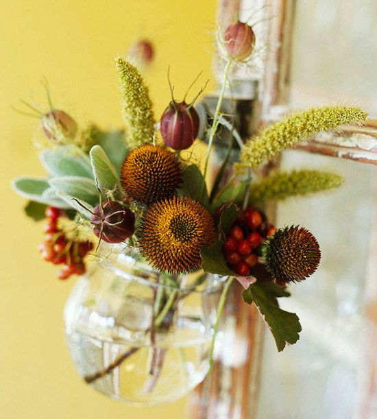 This earthy arrangement is made up of millet, purple coneflower seed heads, and love-in-a-mist seed heads. It has a lot of texture so a simple vase does the trick./