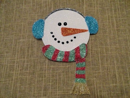 Glittery snowman made from a recycled CD, felt, and pipe cleaners.  @Jodi Dawson would *love* this!