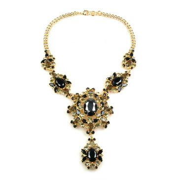 Amazing statement gold plated necklace with bohemian crystals in black and grey hues. Layer it over a simple blazer by day or a cocktail dress by night. #jewellery #necklace #колье