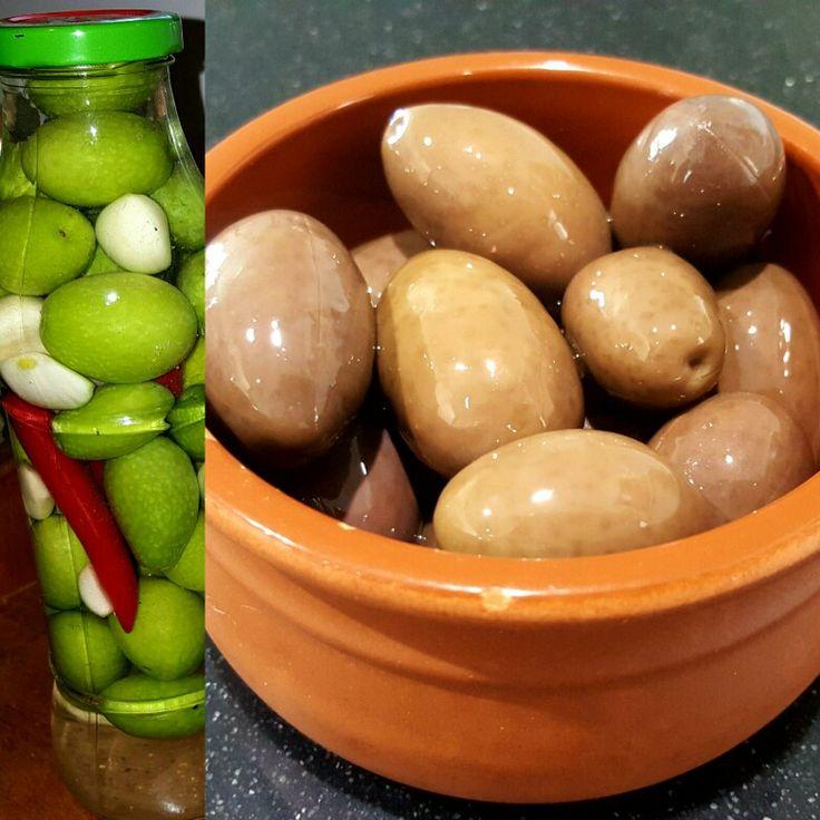Home made olives. Wash olives. Slit with knife. 5 or so cloves garlic. Couple chillies. Salt.