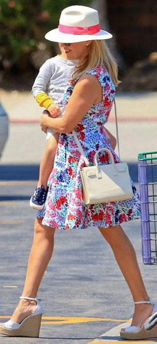 Reese Witherspoon: Purse – Saint Laurent  Dress – Draper James  Shoes – Tabitha Simmons