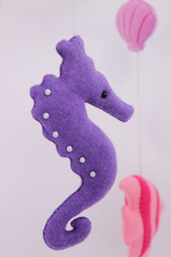 Handmade baby mobile THE SEA is a perfect decoration for the nursery. Your baby enjoy watching this toy. MADE TO ORDER (1 WEEK)!!! Size/Dimensions/Weight --Toys: Dolphins and fish - 10 cm (4) Shells large - 7 cm (3) Small shells - 3 cm (1.2) Sea horse - 17 cm (7) -- Mobile: 46 cm (H)* 30cm (W) (18.4 * 12) Materials utilised -- Felt -- Beads:the eyes of fish, dolphins and seahorses and on starfish -- Synthetic filler -- Wood: basis for mobile Production method - Handmade