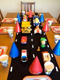Cars and trucks and a road through the dinner table! Fun!