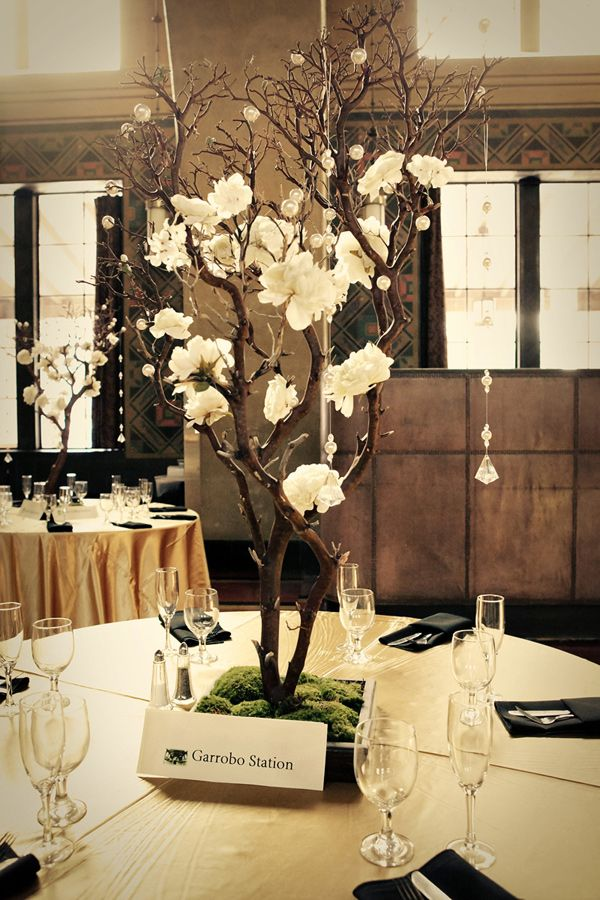 Gorgeous branch and rose/flower of choice centerpieces!