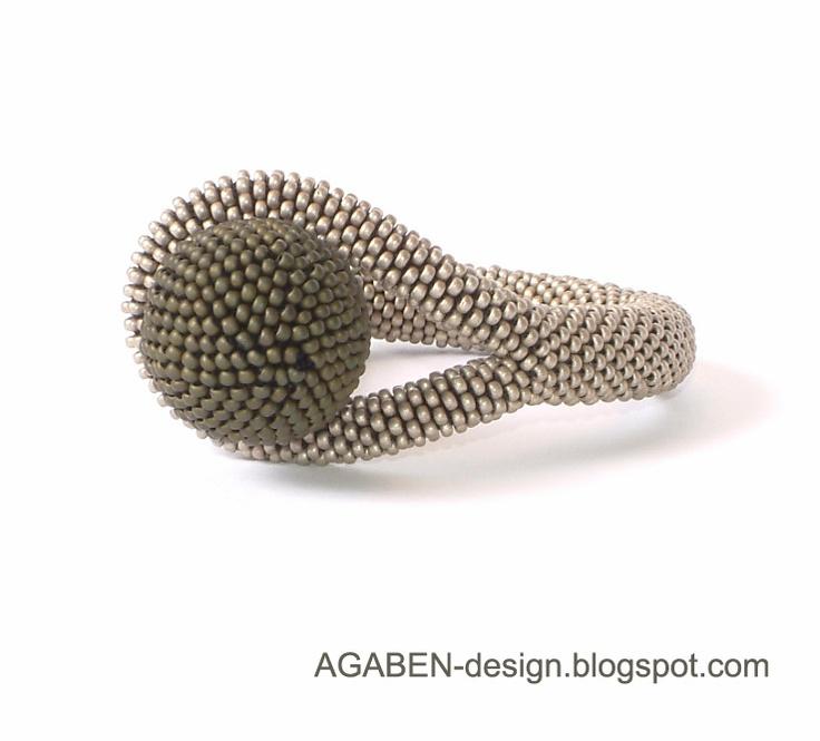Bernadett Varga. Agaben.  Closure loop is bead crocheted into rope.