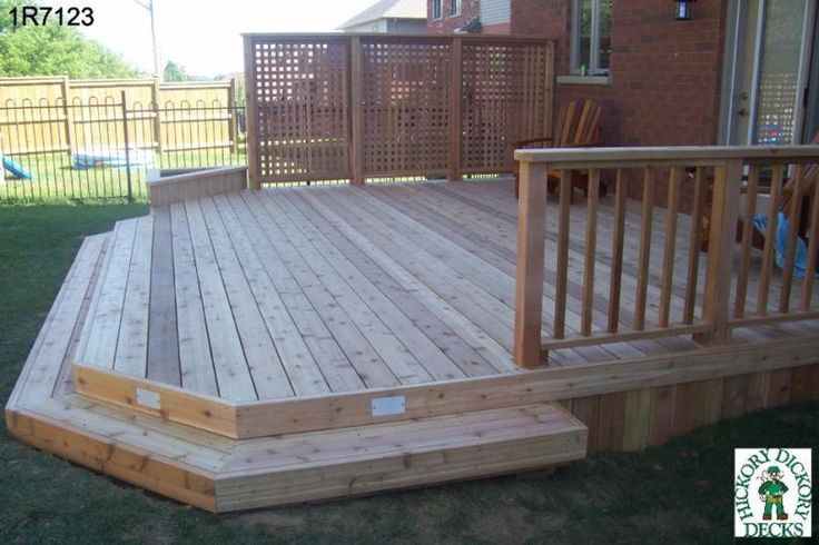 Large, low, single level deck with privacy screen Architectural Landscape Design