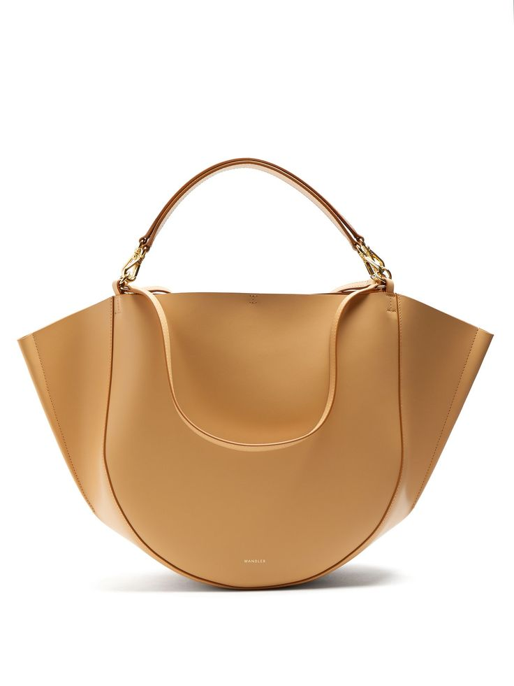 Click here to buy Wandler Mia leather tote at MATCHESFASHION.COM