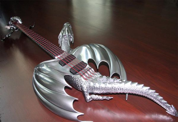 "Created by the master craftsman from Emerald Guitars for a Thai customer Ekkasit, this bass guitar is fashioned after the dragon guitar the artist created for Wang Leehom. The form of this freaky guitar named ""Draco"" is made to resemble an outstretched dragon in flight with most of the details being focused at the back of the sculpture."