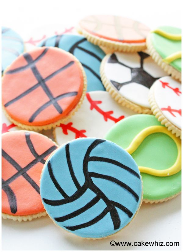 Learn to make these easy SPORTS BALL COOKIES and use them to play a game of tic tac toe. Great for boys birthday parties and even Father's day! From cakewhiz.com