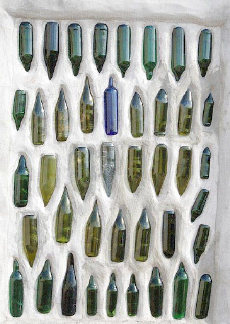 Recycled bottle wall, I like that the bottles are closed in.  I can see nice dry spider homes otherwise.  Just the thing for your black widow colony!