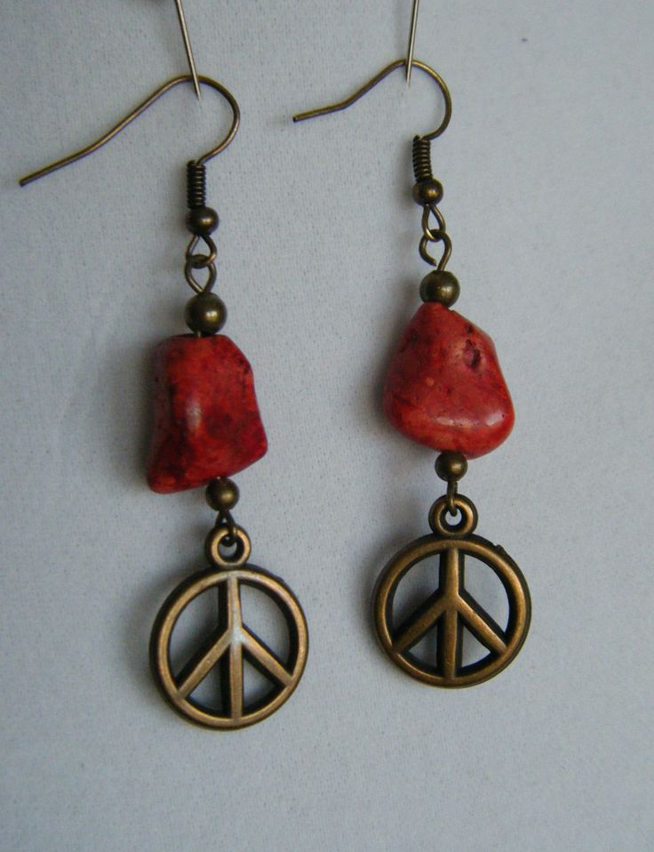 antique brass peace sign with red nugget