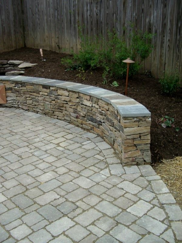 Beautiful Paver Patio With Building Stone Seating Wall In North Arlington.