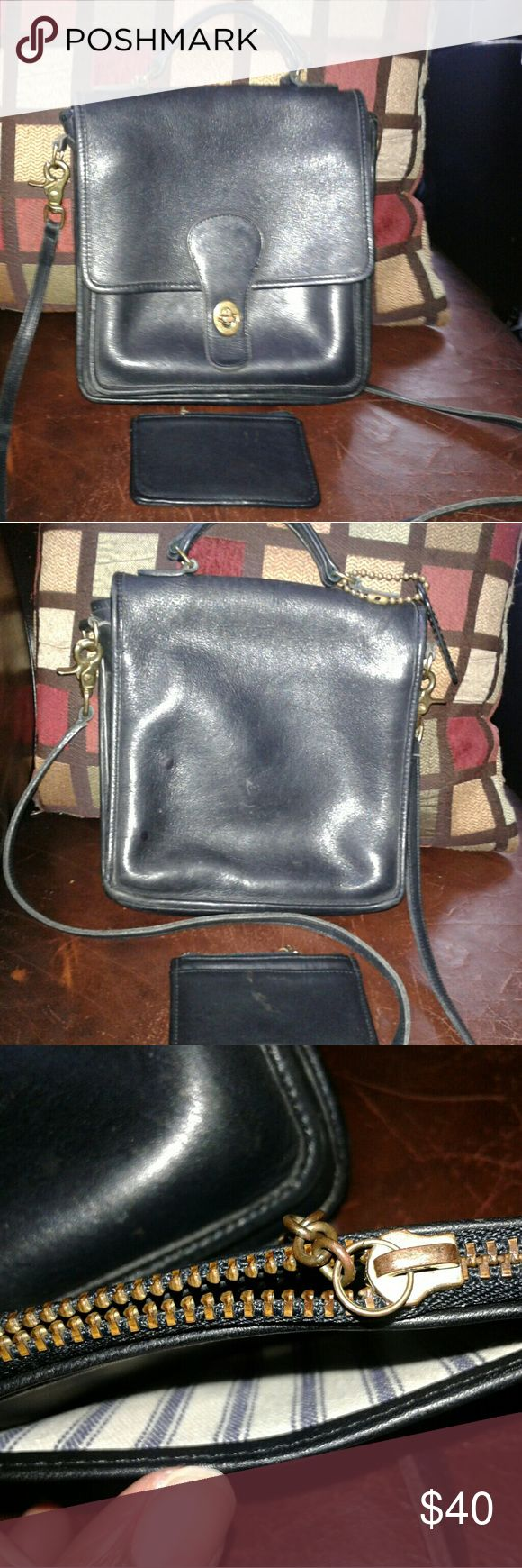 Vintage Coach Satchel Crossbody Bag and Wallet Both of these are black leather vintage items. The wallet is in good preowned condition. The purse has some red stains inside, see pics. The brass hardware has some green tarnishing and need a good cleaning. Coach Bags