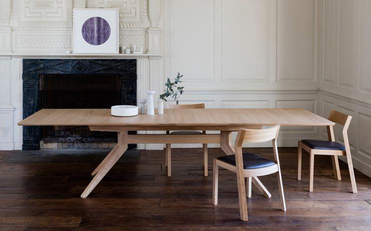 Cross extending table