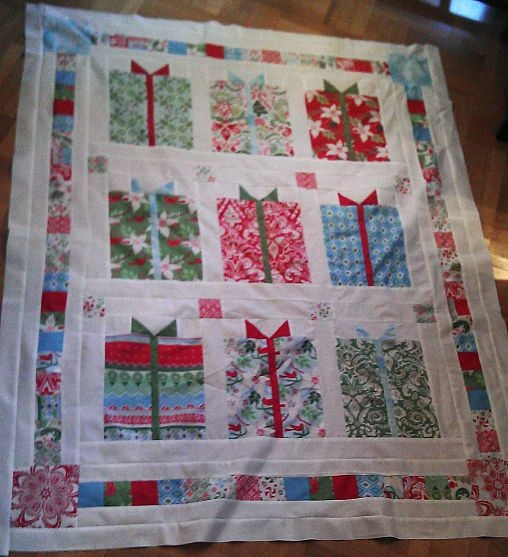 This would be cool if the presents were made with fabric from Lukes Christmas pajamas. Made into a quilt when he is older.
