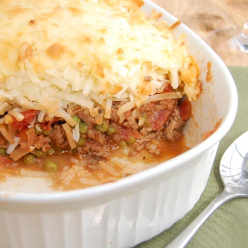 Shepherd's Pie topped with crispy shredded hash browns and cheddar ...