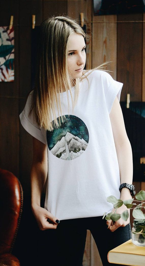 Watercolor print with mountains and zodiac signs great unisex gift for all family. We can made in any size you need. Please, write in comments to your order what size you need.  This painting was made by talented painter from Ukraine. Hand made watercolor painting with night sky and landscape view.  T-shirt made from soft and totally natural cotton fabric.  MADE TO ORDER in next 10-12 days.  Material: 100% cotton  Size: unisex adult sizes- XS, S, M, L  Care: hand wash or machine wash…