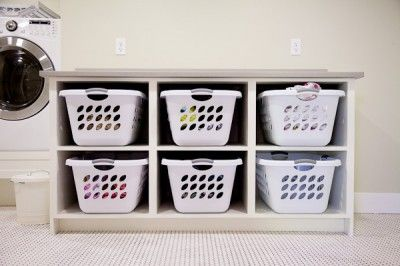 DIY Laundry Room Cabinets - with slightly smaller baskets this can double as a bench. Put coat hanger hooks on the wall above and I'll have a perfect coat and shoe area on the back porch!