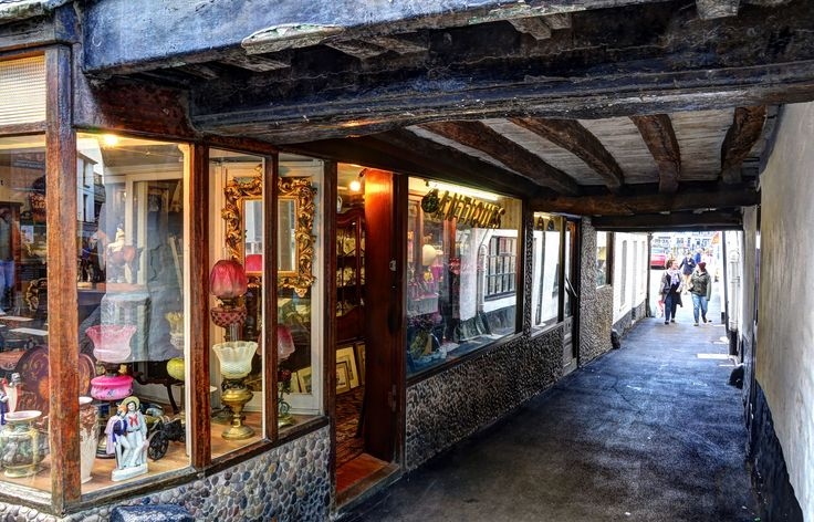 https://flic.kr/p/DYYDvF | Ancient alley in Looe, Cornwall (Explored) | This little antique shop is in Fore Street (the equivalent of the high street) in East Looe in south-east Cornwall. Many of the buildings in this part of the road date from the 1600s, though subsequent alterations can make them appear to be more recent, but in this case the old timbers tell the story.This ancient alley leads through to the harbour and the riverside fish market, and may well have been used by smugglers.