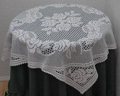 This table topper design I did as an experiment with different ways to use filet. I was so pleased with how it turned out and I will be one of the pieces I pass on to my children or grandchildren. Crochet World included this design in their February issue of Crochet World 2009.
