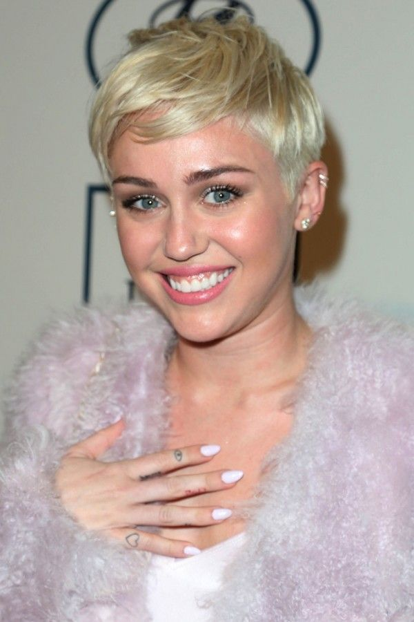 Miley Cyrus with long, white nails