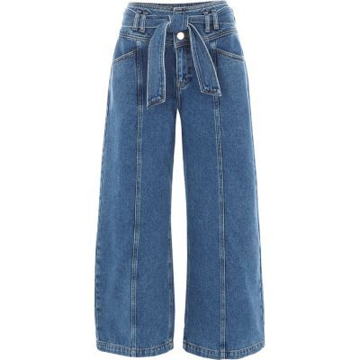 Blue denim Wide cropped leg Centre seam detail Tie belt Belt loops Our model wears a UK 8 and is 175cm/5'9'' tall