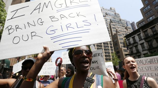 Brigid Turner, a Jamaican national who lives in Brooklyn, holds a sign while chanting during a rally in front of the Nigerian consulate, in New York, Saturday, May 10, 2014. (AP / Julio Cortez)