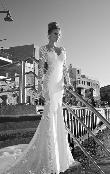 Galia Lahav Wedding Dress Photos on WeddingWire........Tullia  The color of this dress is a tan dusted ivory with sheer shimmering side panels. It has dramatic oval lace details going all along the sides of the dress and along the detachable sleeves. Buttons lining the rear of the dress and the sleeves.