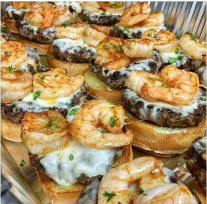 Grilled burgers with Munster cheese and seasoned shrimp!! Two,please!!