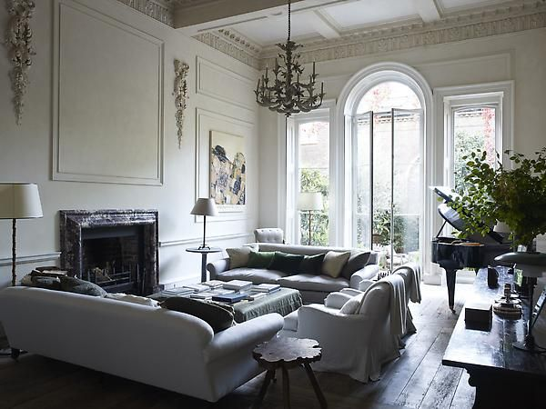 Interior designer Rose Uniacke's refurbished London home is live-ably grand. What a way to combine a modern sensibility with respect for the Victorian past. Don't you want to just curl up on a couch, tuck in the cashmere throw, and read?