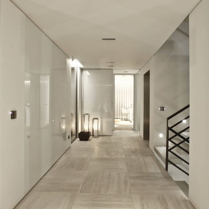 panels of glass perhaps? on white walls and stunning stone floor tiles || contemporary hall entrance || S House by Tanju Özelgin