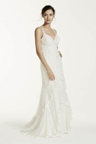 Ideal for thebride to be, you will look lovelyin this romantic sheath gown!  Tank chiffon bodice with sultry v-neckline features eye-catching illusion back.  Piece lace tierswith lace appliques add movement to this flawless gown.  Sweep train.  Limited availability in stores.  Fully lined. Back zip. Imported polyester. Dry clean only. To preserve your wedding dreams, try our Wedding Gown Preservation Kit.