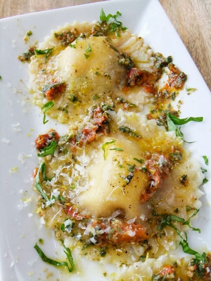 Caprese ravioli with roasted tomato pesto sauce.