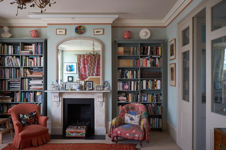 Bookshelves on either side of the fireplace in the master bedroom help convey the home's welcoming, lived-in mood.