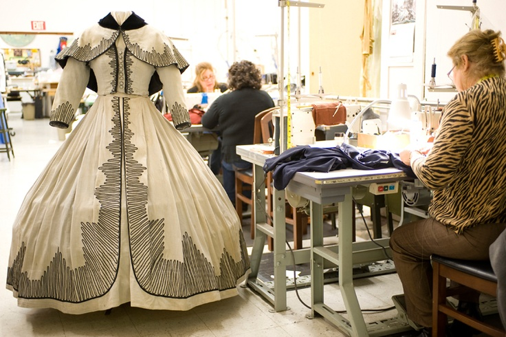 "The women's made-to-order workroom of Western Costume Company. In the foreground is the buckboard dress designed by CD Walter Plunkett for Vivien Leigh in ""Gone With the Wind."" Photo Courtesy of Western."