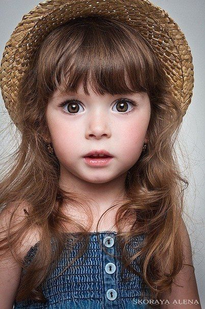 Little girl in straw hat, big brown eyes