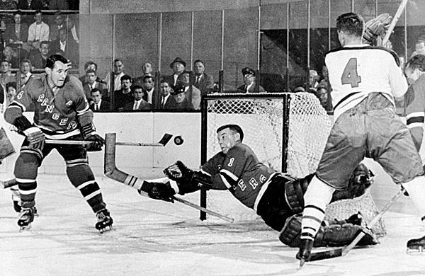 gump worsley stops a puck - 1959