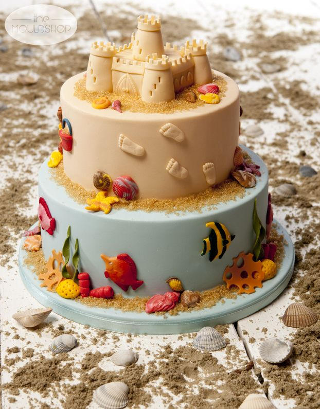 Beach Cake decorated with fondant shells and fish using moulds