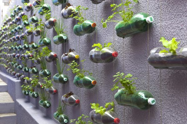 Plastic Bottles Garden by Brazilian design studio Rosenbaum, 2011. This art is helping families recycled plastic bottles and to raise awareness against environmental pollution with plastic bottles. This art is very effective because of the green and beautiful scenery created by it.