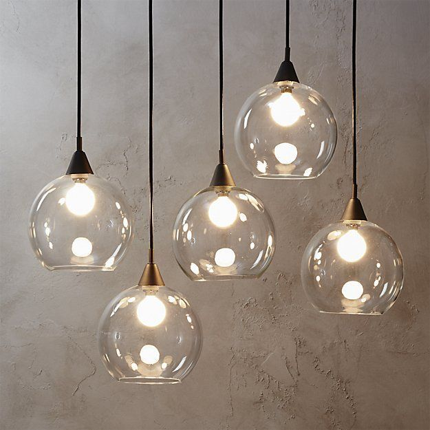 high five. Industrial modern chandelier suspends five glass globes from black… More