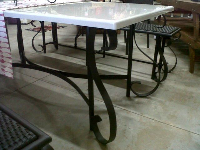 Curl design table with matching benches available.