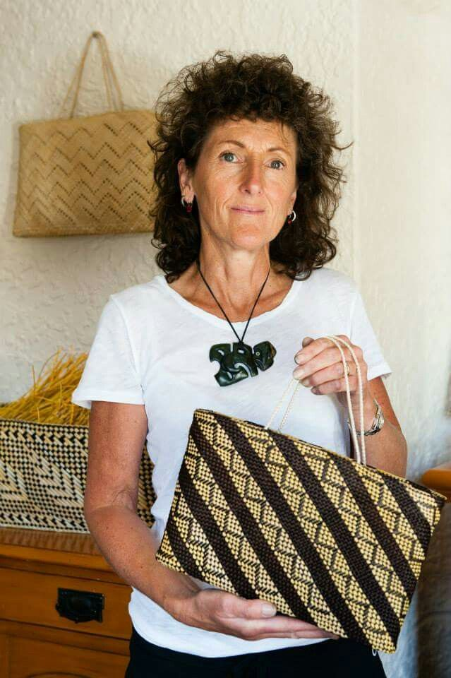 Jill Fleming weaver with kete (maori basket)