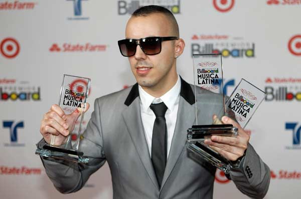 Portuguese-French singer-songwriter Lucenzo poses with his awards for song of the year, digital song of the year and latin rhythm song of the year, backstage during the 2012 Billboard Latin Music Awards in Coral Gables, Florida, April 26, 2012.