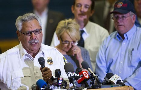 Chief Dan Fraijo speaks as Gov. Jan Brewer wipes away a tear during a press conference about the Yarnell Hill Fire at Prescott High School on Monday, July 1, 2013.