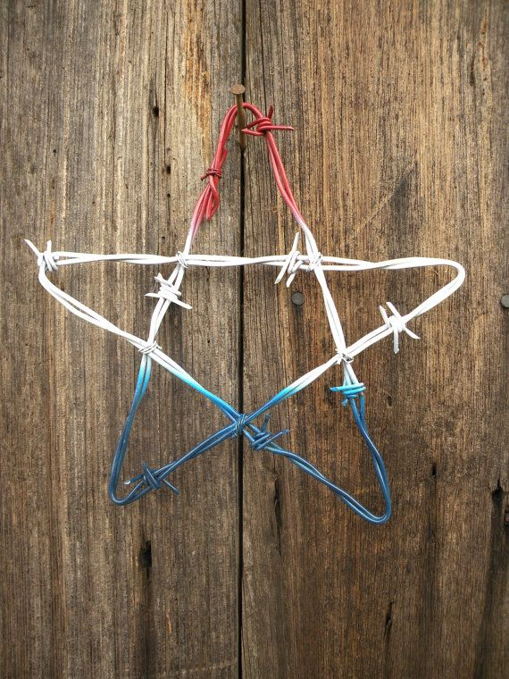 This is old barbed wire off a Georgia cattle ranch hand fashioned into a lot 12 stars and painted various colors. Star measures approximately 8-1/2 x 8-1/2. This is not the actual item.