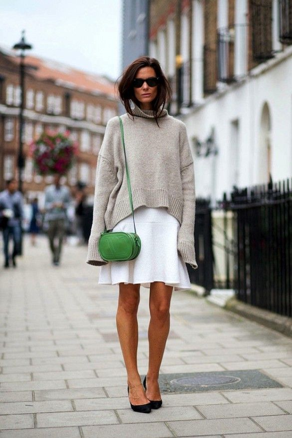 Blogger babe Hedvig Opshaug in a neutral sweater-over-dress look with a bold green bag