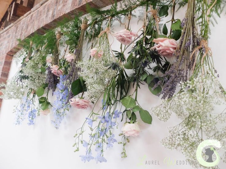 Natural flower backdrop at Owen House Barn - roses, delphinium, lavender and gypsophila - Laurel Weddings - http://www.laurelweddings.com/rustic-wedding-flowers-owen-house-barn/