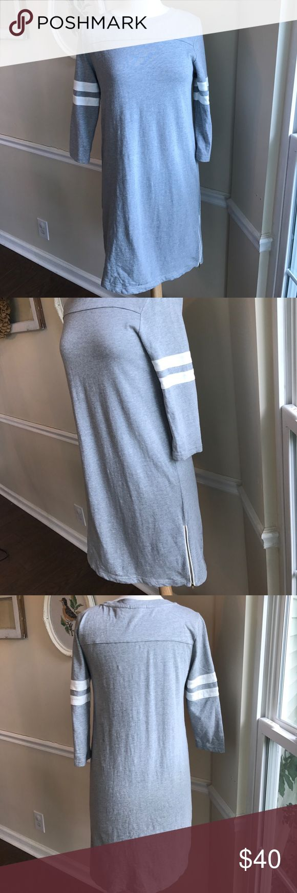 """J. Crew football jersey midi dress with zippers Very cute and comfortable gray, with white stripes, football jersey dress from J. Crew. Adorable stripes on the 3/4 length sleeve and zippers on both sides of the bottom of the dress. Approximately 17.5"""" from armpit to armpit, laying flat. Length from shoulder to hem is 36"""". Pre loved but still in great condition! So easy to wear! 💕Bundle 2 or more items for a private discount!💕 J. Crew Dresses Midi"""